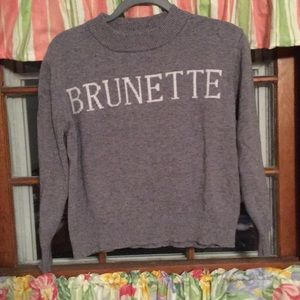 "Grey cotton sweater, white ""BRUNETTE"" lettering"